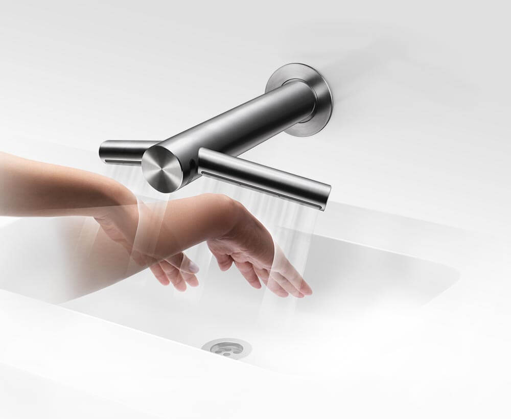 The Dyson Airblade Tap hand dryer drying hands